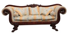 AN IMPRESSIVE LARGE REGENCY IRISH MAHOGANY SETTEE with scrolled ends and shaped leaf carved suppo