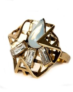 """Kay Ring from Nicole Romano.   Redefine your ring collection with this folded triangular grid structure encasing crystal and opal gems.   1"""" x 1.25"""" ornament dimension Swarovski crystal and vintage opalescent tear drop 18K gold plate. Antiqued and hand polished.  Handcrafted & USA Made™"""