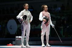 Lee Kiefer of United States and Mona Shaito of Lebanon look on prior to their match during the women's foil individual in the Rio 2016 Summer Olympic Games at Carioca Arena 3.