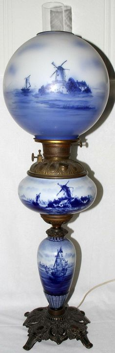 DELFTWARE BLUE & WHITE PORCELAIN BANQUET LAMP,Hand painted with a sailing scene. Brass base. Glass globe.