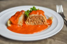 Cabbage Rolls with a heavenly Tomato Cream Sauce -- deliciously seasoned ground beef and rice wrapped in cabbage and served with an INCREDIBLE sauce! http://crumbsandtales.com/cabbage-rolls-with-tomato-cream-sauce/