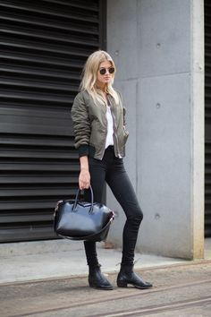Black jeans, boots, bomber jacket, Givenchy bag.