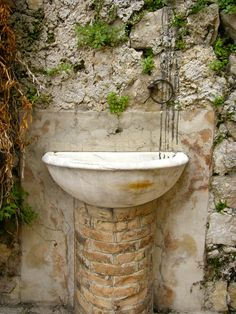 A simple fountain made from an old sink, cemented in to bring tranquility to all who pass by ~ soooooothing!