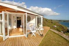 Love it! A tiny that opens to the sea. The Edge, a tiny one-bedroom beach cottage in Cornwall. | www.facebook.com/SmallHouseBliss