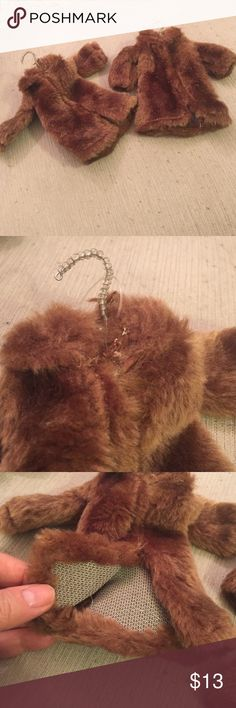 Fashionista fur coat ornaments. Set of two NWOT Listing for two fur coat ornaments as shown. Perfect for Christmas tree or other fashionista decorative idea. Each is about six inches up and down. Still has plastic tag loop but no tag. New. Never used. From store stock. Soft brown faux fur. Style of the little coat is shawl collar and opens in the front.   I have more of these available. Three sets of two listed. Other