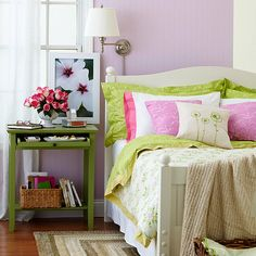Bold and Bright :: When paired with dark wood floors, pastels can pack quite a punch. In this room, feminine lilac walls, dark flooring, and a woven rug combine for cozy cottage appeal. An apple-green table and bubblegum-pink pillows make unlikely but lovely accents.