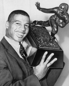 As fast as Ernie Davis became a national icon, he was gone.    Davis led the Syracuse Orangemen to their only national football championship in 1959 (an undefeated season) and became the first African-American athlete to win the Heisman Trophy as a senior in 1961. But soon after being chosen with the first pick of the '62 draft by the Redskins and then being traded to the Browns, Davis was diagnosed with leukemia.    He died at the young age of 23, his legacy firmly intact.