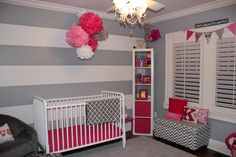 I love the grey and white stripes on one wall with grey on the rest.  Very pretty.  I could accent with boy or girl colors.