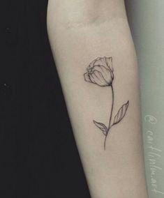 Minimalistic tulip tattoo