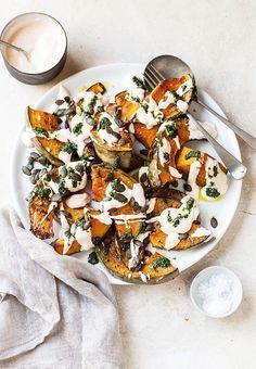 Gerösteter Kürbis mit Chili Joghurt und Koriander Sauce I worship at the food altar of Yotam Ottolenghi, and this recipe for roasted pumpkin (squash) with chilli yoghurt and coriander sauce is the first recipe I'm trying from his new cook book Ple… Healthy Recipes, Vegetarian Recipes, Cooking Recipes, Salad Recipes, Think Food, Food For Thought, Ottolenghi Recipes, Yotam Ottolenghi, Ottolenghi Plenty