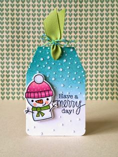 """Donna Mikasa - three umbrellas: Holiday Tags - such beautiful coloring.  Looks like texture embossed snow background but it's the no mess snow.  """"See the background? It's an old technique that looks like embossing paste. I ink distressed the top portion of the tag and used an embossing folder that looks like falling snow. Then I used a sanding block and gently went over the dots and """"took away"""" the color. Embossing paste look without the mess!"""
