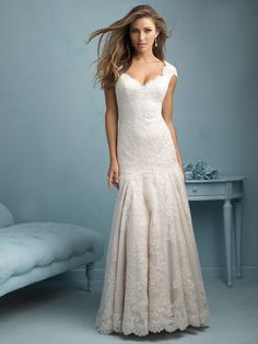 Allure 9208  Delicate lace and a slim silhouette make this gown truly timeless.