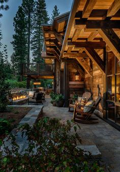 Love the stone patio *C Outdoor lounge and fireplace for the beuatiful winter cabin house Rustic Exterior, Exterior Design, Cabin Homes, Log Homes, Timber Homes, Texas Mansions, Winter Cabin, Kabine, Cabins And Cottages