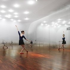 Beijing based architectsTsutsumi and Associates have completed this dance studio in Beijing with mirrored walls covered in tiny graduated dots to create the illusion of a mist hanging in the air. Called ANZAS Dance Studio, the interior has tigerwood flooring and spotlights dotted across the ceiling. Curves in the apex of each corner further blur