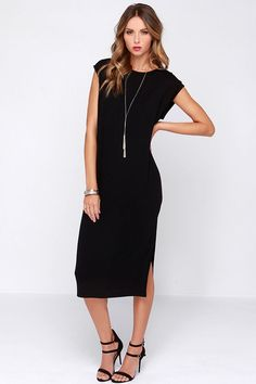 A Kiss Away Black Midi Dress There's nothing quite like a cute and casual dress that can multitask as well as the A Kiss Away Black Midi Dress! Perfect for your next afternoon or evening out, this lightweight jersey knit shift dress has a round...
