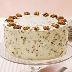Italian Cream Cake | This cake will surely win rave reviews in your home with its sweet coconut flavors and Nutty Cream Cheese Frosting