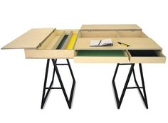 Flip Table by No Problem - a kitchen table that can also  be used as a workspace.  Store work items inside the table during meal times.