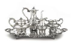 A VICTORIAN SILVER FOUR-PIECE PRESENTATION TEA SET WITH SIMILAR TWO-HANDLED TRAY, WILLIAM HUNTER / EDWARD AND JOHN BARNARD, LONDON, 1845 / 1855 comprising a crested Teapot, Coffee Pot, Creamer, and Sugar Bowl and a similar two-handled tray engraved with later presentation inscription and the hospital emblem