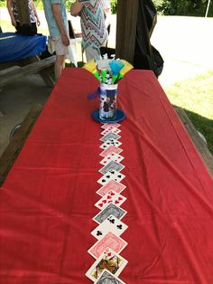 """Table runners of playing cards taped together with masking tape on the back . Centerpieces of shuttlecock """"flowers"""" and crossword puzzle paper and a photo lining the vases . For my parents' Years of Fun and Games"""" anniversary party Las Vegas Party, Casino Night Party, Casino Theme Parties, 21st Party, Party Party, Party Dress, Magic Party, Poker Party, Guys And Dolls"""