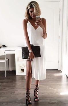 White dress & lace up heels.