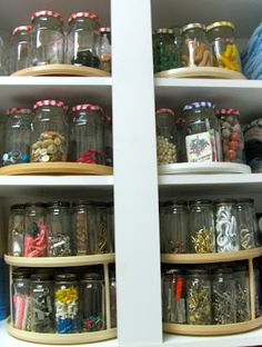 Re-use jars to hold small items and place on a lazy susan to make them all more accessible in a small space.