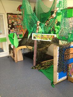 Jungle explorers role play - half for children to hide and explore and half for the children to role play as animals Amanda Rainforest Classroom, Jungle Theme Classroom, Classroom Themes, Classroom Displays, Rumble In The Jungle, Welcome To The Jungle, Jungle Activities, Giraffes Cant Dance, Book Area