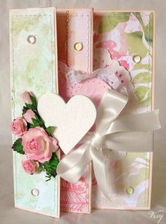 Gorgeous Card...score and fold at 4, 10 and 16 cm. Decorate each panel with different paper, cut slit in from panel and slide ribbon through it and tie in front. Paper 15x27 cm.