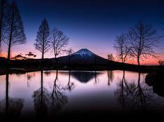 National Geographic   -    Mount Fuji looms over Fujinomiya, Shizuoka Prefecture, Japan, after a heavy rainstorm. Photo by  Hidenobu Suzuki.