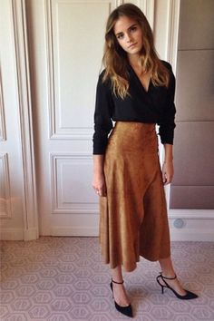 Who: Emma Watson What: A Tan Suede Skirt Why: While we associate tan suede with its more boho leanings, Watson takes the fabrication to demure places in a Ralph Lauren skirt and blouse. Get the look now: Ralph Lauren skirt, $1,995, ralphlauren.com.