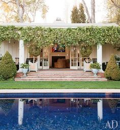 Roger Davies for Architectural Digest  back of family room with french doors and steps to garden