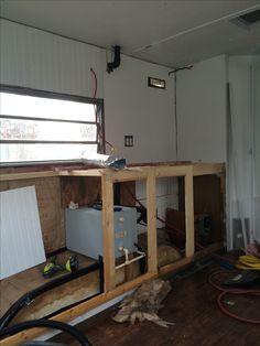 Kitchen cabinets being built.