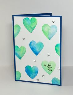 Blue and Green Valentine - Scrapbook.com - Pretty watercolored hearts on this handmade card!