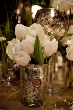 White tulips and mercury glass make for a gorgeous centerpiece! What do you think? {Tiffiney Photography}
