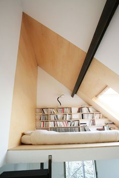 Attic library with bed