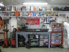 Peg board, welding cart, shelves everywhere.