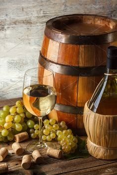 Still life with wine Photos Still life with wine bottle, glass and barrel by Grafvision photography