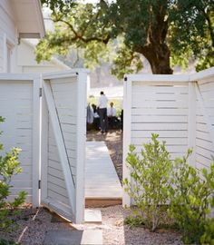side yard gate, walkway with peastone