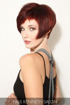 A bold garnet hue provides impeccable contrast to the model's fair skin tone, only to be topped with an angular cut and cropped bangs.