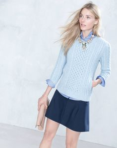 J.Crew cabled pocket sweater, Boy shirt in end-on-end and the jeweled plates necklace.  They need to re-define what a skirt is!