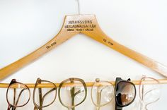 These eye/sunglasses look so lovely lined up together on the wooden hanger: