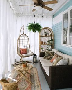a small boho sunroom with a dark sofa, wicker furniture and a hanging chair plus… - Home Decoration Small Sunroom, Small Balcony Decor, Small Enclosed Porch, Conservatory Decor Small, Conservatory Interiors, Small Balcony Design, Patio Design, Sunroom Decorating, Interior Decorating