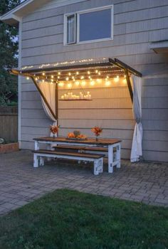 Build a super frugal pergola decorated with string lights.