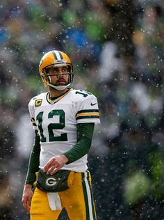 Quarterback Aaron Rodgers of the Green Bay Packers walks off the field during the 2015 NFC Championship game against the Seattle Seahawks at CenturyLink Field on January 2015 in Seattle, Washington. The Seahawks defeated the Packers in overtime. Packers Vs Seahawks, Packers Baby, Go Packers, Green Bay Packers Fans, Packers Football, Seattle Seahawks, Greenbay Packers, Football Season, Football Memes