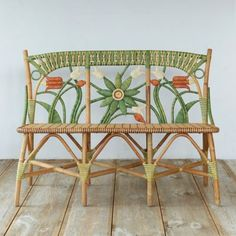 """Inspired by an antique find, this natural rattan bench is intricately wrapped and colored to form an eye-catching floral motif.- A terrain exclusive- Rattan wicker, sealant- Wipe clean with slightly damp cloth; avoid excess contact with water- Indoor use only- Seat: 18""""H, 17.3""""D- Imported37""""H, 52""""W, 21""""D"""