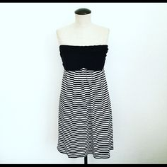 Express Striped Dress Your new favorite Summer dress!  Light cotton strapless dress in a bold black and white stripe pattern.  Bodice has slight ruching detail on front and back.  In great condition! Express Dresses Strapless