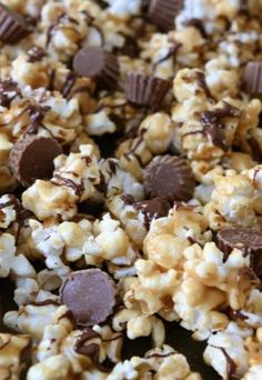 Reese's Peanut Butter Popcorn Recipe on twopeasandtheirpod.com Peanut butter popcorn with Reese's Peanut Butter Cups and a drizzle of chocolate! We LOVE this popcorn!