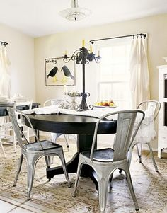 Tolix chairs with round table
