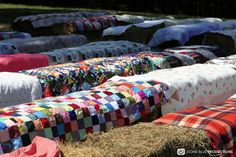 Seating for a country wedding - great idea! Quilts and bales of hay