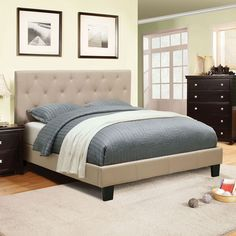 Create+a+simple+yet+inviting+atmosphere+in+your+bedroom+with+this+contemporary+Leeroy+Platform+Bed+(Ivory)+by+Furniture+of+America.+The+bed+is+fully+fabric+upholstered+and+features+a+padded,+button-tufted+headboard.