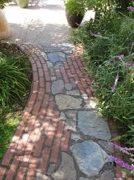Love the dual use of stone and brick on this garden path